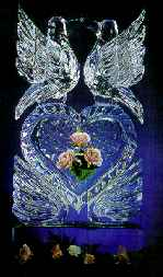 Elegant ice sculpture of an ice heart with your love ones favorite flowers frozen in time.